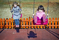 Two girls on the swing Royalty Free Stock Images