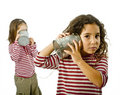 Two girls talking on a tin phone Royalty Free Stock Photo