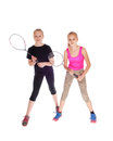 Two girls with tennis racquet. Royalty Free Stock Photo