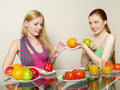 Two girls with vegetables and fruit Royalty Free Stock Images