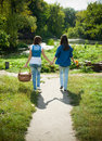 Two girls walking hand in hand Royalty Free Stock Photo