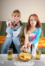 Two girls watching TV Stock Images