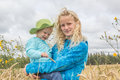 Two girls in a wheat field Royalty Free Stock Photo