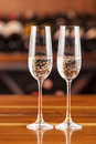 Two glass of champagne in background with bottles of wine Royalty Free Stock Photo