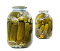 Two glass jars with cucumbers Royalty Free Stock Images