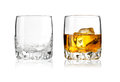 Two glass of scotch whiskey and emty on a white background Stock Images