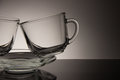 Two glass for tea and an empty saucer on a black background Royalty Free Stock Photo