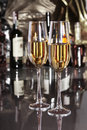Two Glass of wine, brandy or cognac on the mirror wooden table Royalty Free Stock Photo