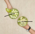 Two glasses of apple martini Royalty Free Stock Photo