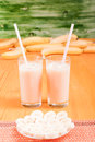 Two glasses of banana juice on the table next to a yellow ripe b Royalty Free Stock Photo