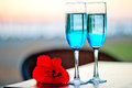 Two glasses with blue alcohol cocktail with an exotic flower Royalty Free Stock Images