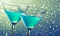 Two glasses of blue cocktail on dark green tint light bokeh background table Stock Image