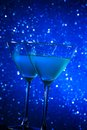 Two glasses of blue cocktail on table dark tint light bokeh background Royalty Free Stock Photos