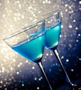 Two glasses of blue cocktail on table white and dark tint light bokeh background Stock Image