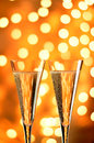 Two glasses of champagne against bokeh background close up plenty copy space Royalty Free Stock Image