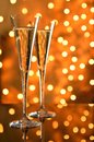 Two glasses of champagne against bokeh background on a reflective table Stock Image
