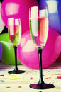 Two glasses of champagne and balloons on party Royalty Free Stock Photo