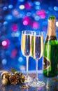 Two glasses of champagne with a christmas decor in the background very shallow depth field focus on near glass Stock Photo