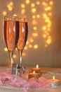 Two glasses of champagne and a gift Stock Images