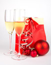 Two glasses with champagne and present on white Stock Photos
