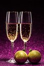 Two glasses of champagne ready for christmas celebration on purple background Stock Photography