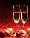 Two glasses of champagne ready for christmas celebration on red background Stock Photo