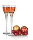 Two glasses of champagne with red Christmas ball Stock Image