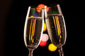 Two glasses of champagne toasting against bokeh lights background Royalty Free Stock Photos