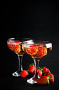Two glasses of cold champagne with strawberries on a black background close up Stock Photography