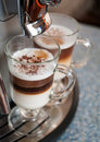 Two glasses fileed with capuccino Royalty Free Stock Photo