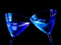 Two glasses of fresh cocktail with ice make cheers on blue tint light space for text Stock Photo