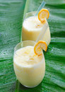Two glasses of fruity banana smoothie Royalty Free Stock Photo
