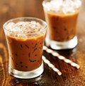 Two glasses of iced coffee shot with selective foc us Stock Photos