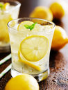 Two glasses of lemonade shot close up with selective focus Stock Photography