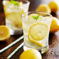 Two glasses of lemonade shot close up with selective focus Royalty Free Stock Image