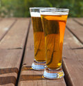 Two glasses of light beer on a table outdoors Stock Photo