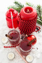 Two glasses of mulled wine and candle with christmas decorations red around Royalty Free Stock Photography