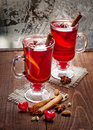 Two glasses of mulled wine on old wooden table with red hearts in winter frosty day Stock Photography