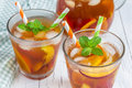 Two glasses of nectarine iced tea Royalty Free Stock Photo