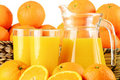 Two glasses of orange juice and fruits Royalty Free Stock Images