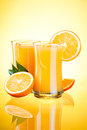 Two Glasses of Orange juice, half oranges Royalty Free Stock Photos