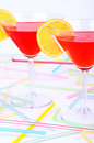 Two glasses with red cocktail front vertical on lemon slices view Royalty Free Stock Image