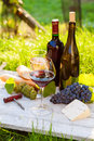 Two glasses of red and white wine and bottle cheese baguette Stock Photo