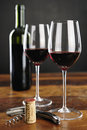 Two glasses of red wine barolo cork with italia and corkscrew selective focus Royalty Free Stock Photography