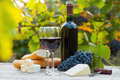 Two glasses of red wine and bottle cheese baguette Royalty Free Stock Photo