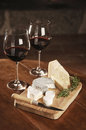 Two glasses of red wine and cheese selective focus Royalty Free Stock Photo