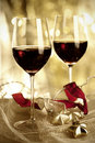 Two glasses of red wine and christmas ornaments selective focus Stock Photos