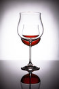 Two glasses with red wine, creating the illusion of three Royalty Free Stock Photo