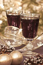 Two glasses of red wine with decoration detail a christmas banquette Stock Photos