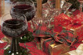 Two glasses of red wine and gifts Royalty Free Stock Photos